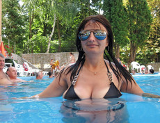 Busty MILFs in bikini and swimsuits, on vacation.