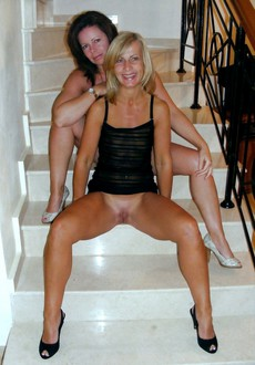 Two lovely MILF lesbians photographing nude so..