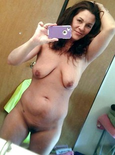Nude old women take self-shot pictures being..