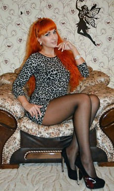 Sexy redhead milf posing for her husband in..