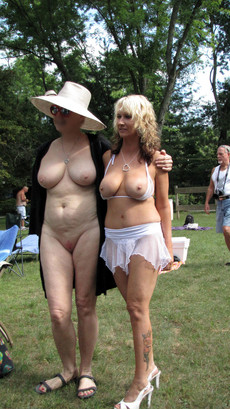 Busty old and young women in the summer nudist..