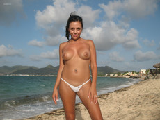 Busty milf baring her breasts and camel toe on a..