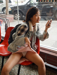 Young asian girl tourist flashing her panties in..