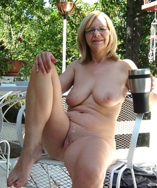 Fully naked english granny drinks coffee on the..