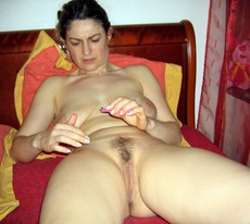 Amateur housewife with hairy twat undressing at..