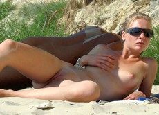 Beautiful nudist women taking sun baths on the..