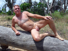 Hairy mature male posing nude on the nature