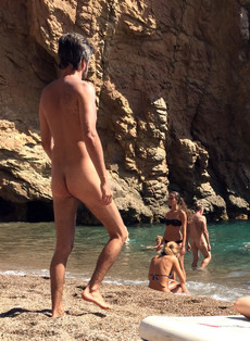 Dude flashes his swarthy cock at the nudist beach