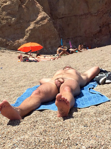 A naked guy sunbathing near me