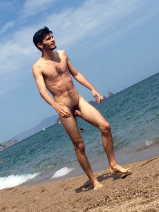 Slender dude naked on the beach