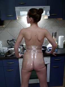 Totally nude young housewife with big protruding..