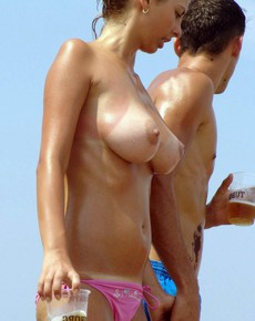 Sexual youngster sunbathe topless on the beach